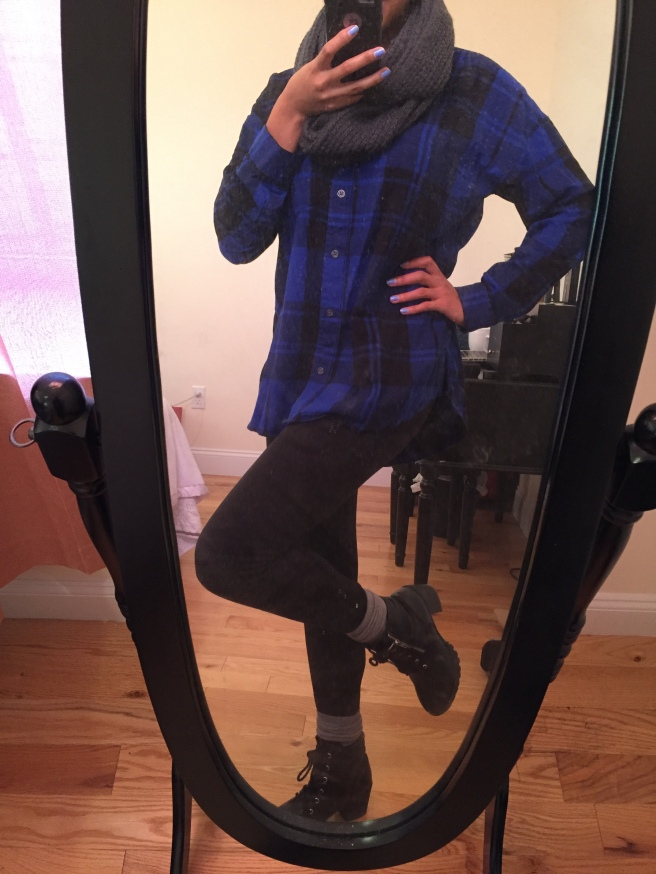 Black leather ankle boots, scrunched gray knee high socks, black leggings, blue and black plaid boyfriend button down, gray infinity scarf. Photo by Mara Lucas