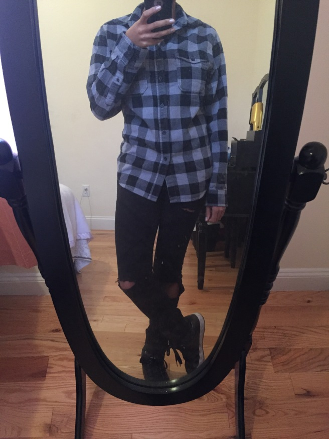 Black and gray flannel over black distressed jeans with black high top sneakers. Photo by Mara Lucas.