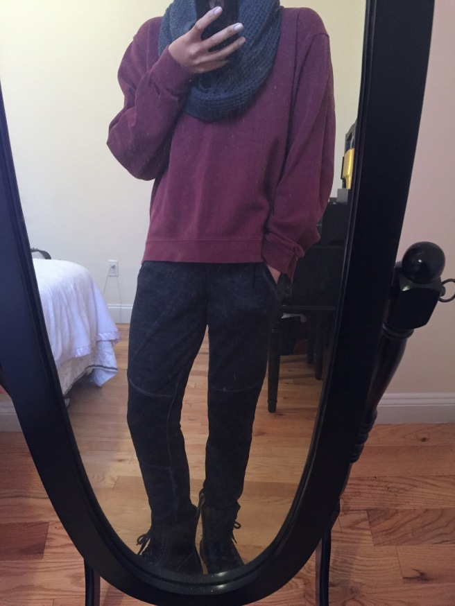 Burgundy men's sweatshirt over gray joggers with black Dr. Marten's boots. Photo by Mara Lucas.