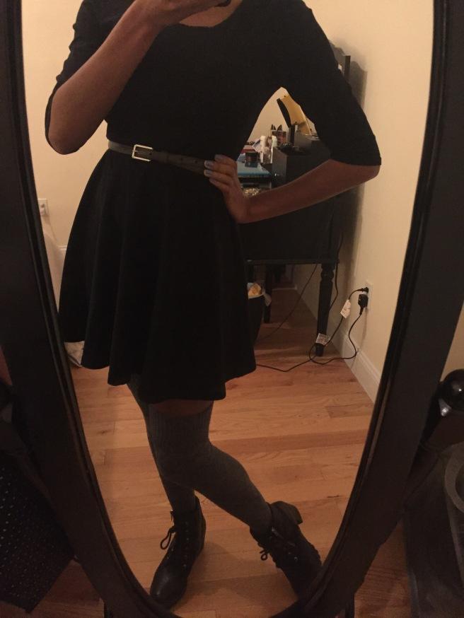 Black leather ankle boots, gray over the knee socks, black skater dress, gray skinny belt. Photo by Mara Lucas