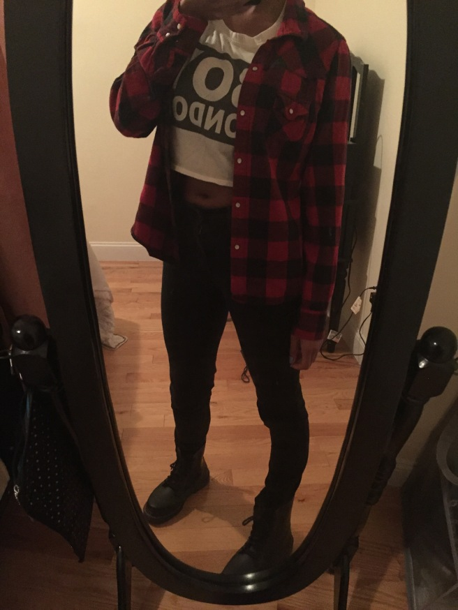 Graphic crop top, red flannel, high waisted black jeans, black D. Martens. Photo by Mara Lucas.