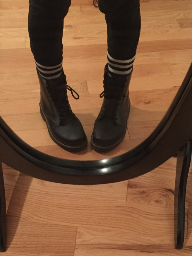 Black Dr. Marten rain boots, Black and white striped socks, black high waisted skinny jeans. Photo by Mara Lucas