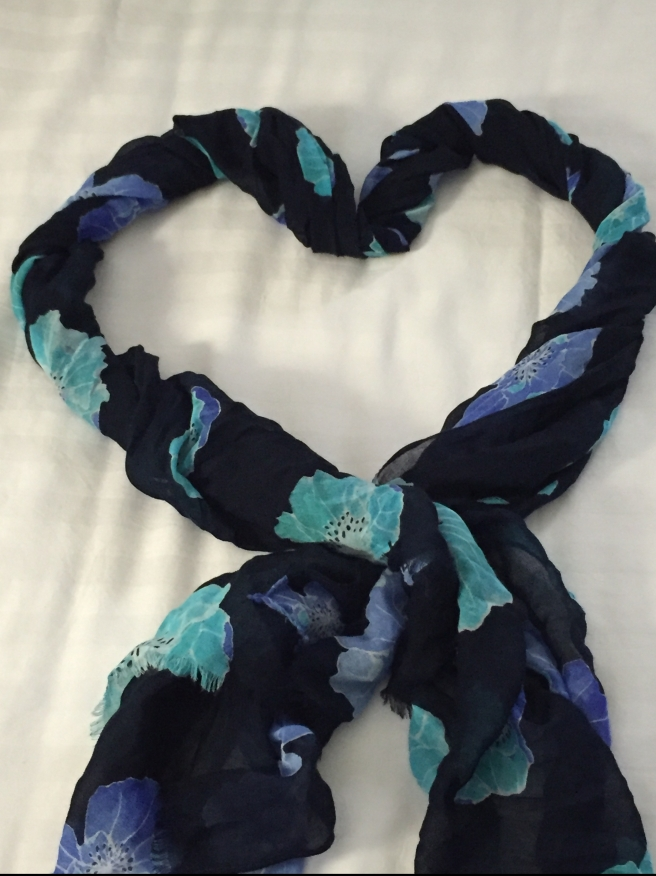 Blue floral scarf in heart shape. Photo by Mara Lucas.